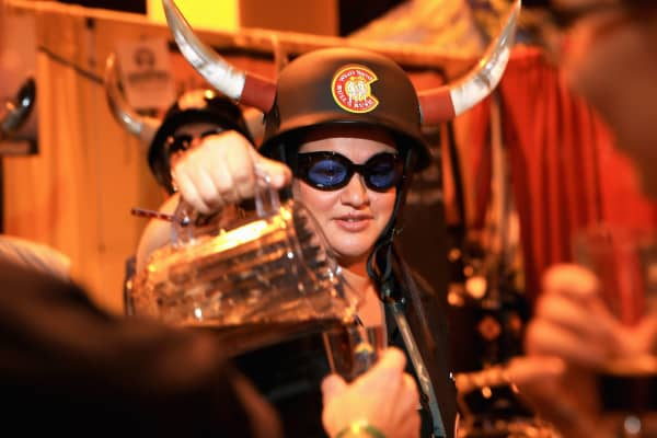 A woman pours beer at the Great American Beer Festival in Denver.