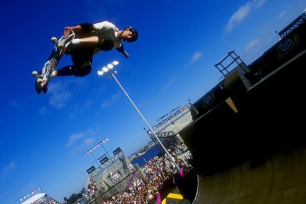 Tony Hawk grabs his skateboard vertical as he jumps from the ramp during the X-Games in San Diego, California.