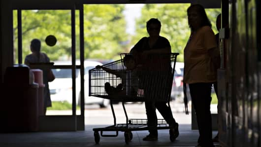 The silhouette of a customer is seen pushing a cart at a Costco Wholesale store in Naperville, Illinois.
