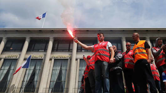 People demonstrate in Le Havre on May 26, 2016 against the government's proposed labor reforms.
