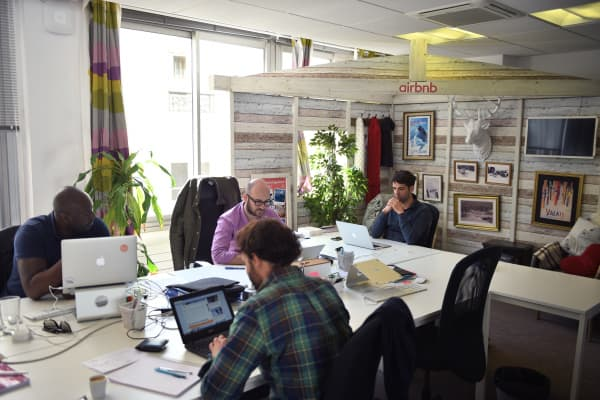 Employees of online service Airbnb work in the Paris office.