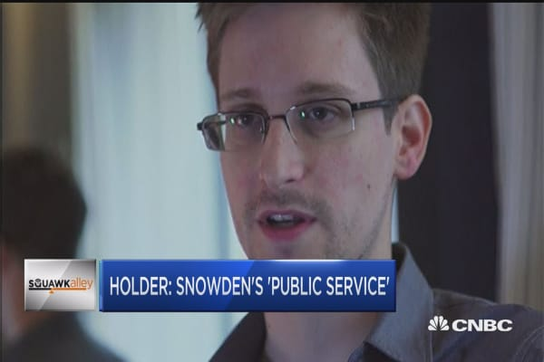 Holder gives Snowden credit