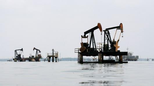 Oil pumps are seen in Lake Maracaibo, in Lagunillas, Ciudad Ojeda, in the state of Zulia, Venezuela.