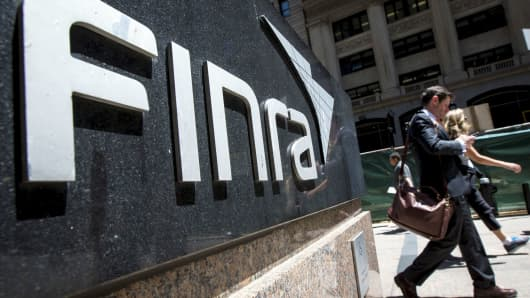 A sign for the Financial Industry Regulatory Authority (FINRA) is seen outside the offices in New York's financial district.