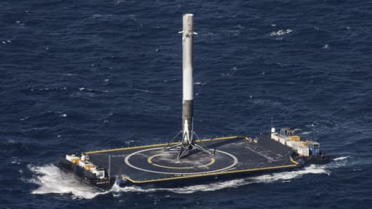 SpaceX's Falcon 9 rocket stands after making its first successful upright landing on the 'Of Course I Still Love You' droneship on April 8, 2016, some 200 miles offshore in the Atlantic Ocean after launching from Cape Canaveral, Florida.