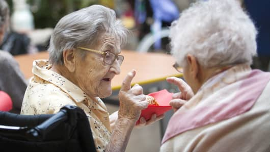 Elderly women speak to each other