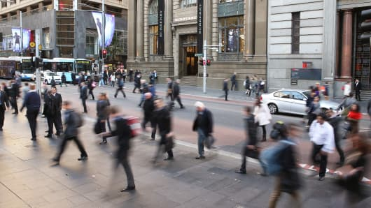 Commuters walk through Martin Place in the central business district in Sydney, Australia.