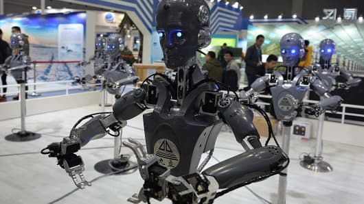 Industrial robots 'dance' at a booth at the China International Industry Fair at National Exhibition and Convention Center in Shanghai.