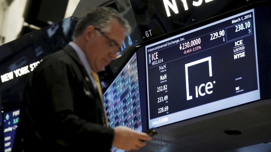 A trader passes by a screen that displays the trading info for Intercontinental Exchange Inc. (ICE) on the floor of the New York Stock Exchange (NYSE) March 1, 2016.