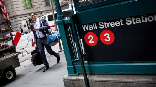 A pedestrian walks past a Wall Street subway station near the New York Stock Exchange.