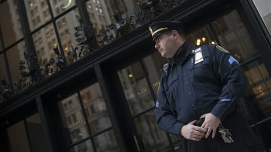 A Federal Reserve Police officer stands guard in front of the New York Federal Reserve Building in New York.
