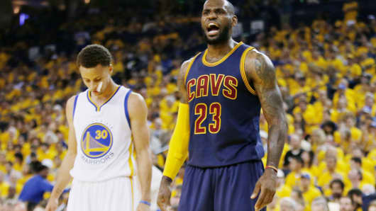 LeBron James #23 of the Cleveland Cavaliers (right) and Stephen Curry #30 of the Golden State Warriors.