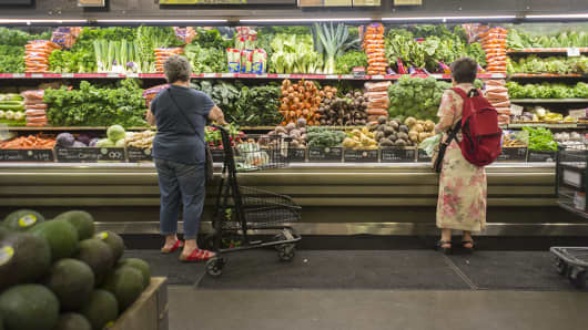 Shoppers browse produce at the Whole Foods Market