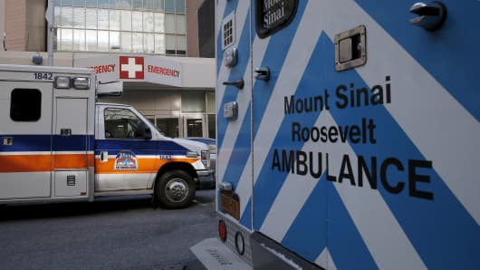 Ambulances are parked outside the emergency room entrance at Mount Sinai West, Roosevelt Hospital in midtown Manhattan, in New York.