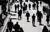 Pedestrians walk past the New York Stock Exchange in New York.