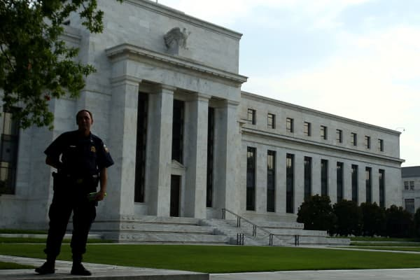 Police office patrols the surroundings of the Federal Reserve