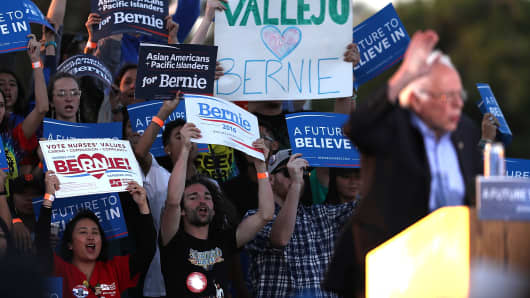 Supporters cheer as Democratic presidential candidate Sen. Bernie Sanders speaks at a campaign rally at Waterfront Park on May 18, 2016 in Vallejo, California.