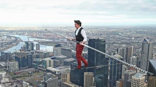 High-wire artist Kane Petersen walks a tightrope at Eureka Skydeck on September 16, 2015 in Melbourne, Australia