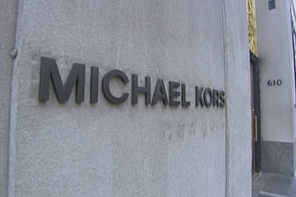 Michael Kors cutting down on discounted handbags