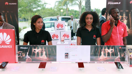 Local employees introduce the company's cellphones during a show by Chinese tech firm Huawei in Lusaka, Zambia, April 13, 2016. Chinese tech firm Huawei on Wednesday held a show in Zambia of its high-end products and services.