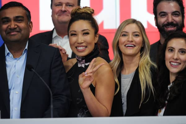 YouTube's chief product officer Neal Mohan, left, with YouTube stars Cassey Ho, center, and iJustine, front second-right, at Nasdaq on May 5, 2016.