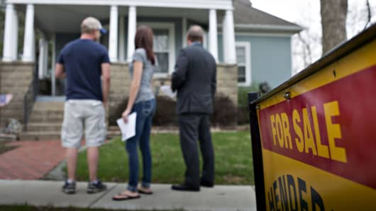 Prospective home buyers tour a house for sale with their realtor in Machinaw, Illinois.