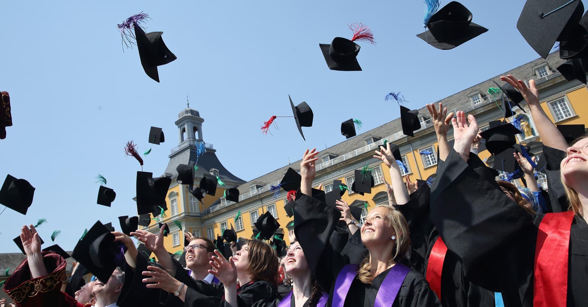 College Graduate toss caps