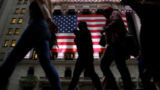 People pass by the New York Stock Exchange.