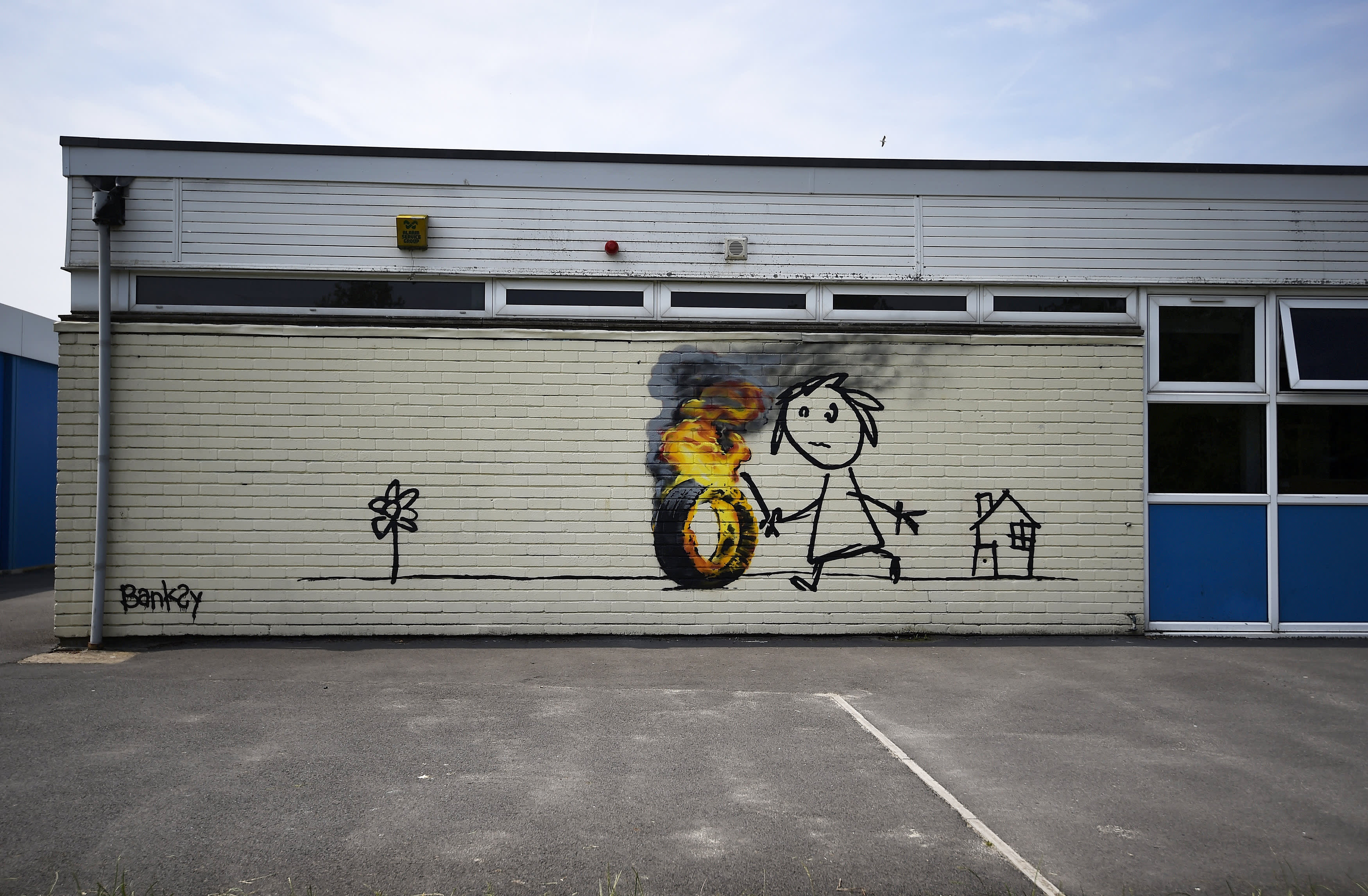 banksy goes back to school with a new mural