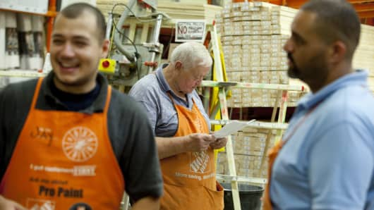 A senior citizen working at Home Depot.
