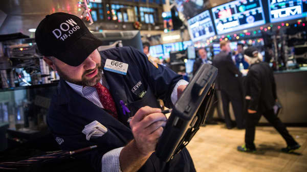 Traders wear hats that say 'DOW 18,000' as they work on the floor of the New York Stock Exchange. (File photo).