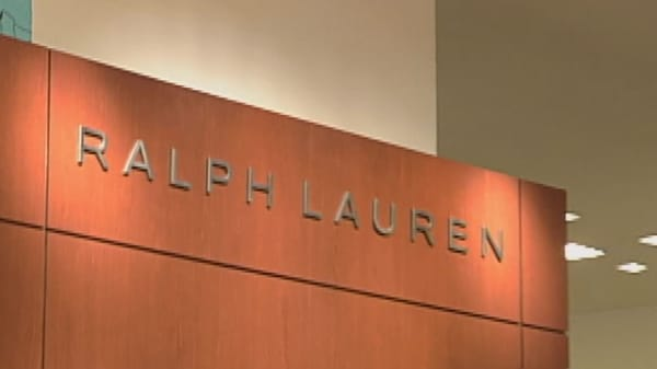 Ralph Lauren plans to cut management, close stores