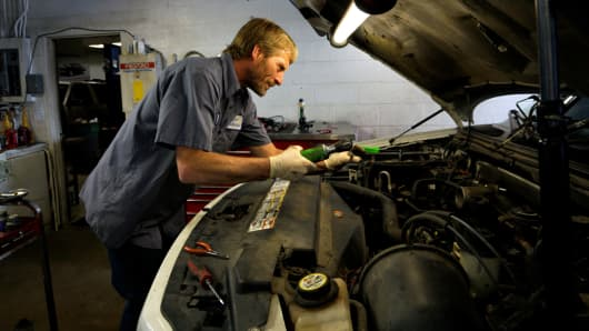 Mechanic Donnie Asher works on a car at Corner Mechanic in Golden, Colorado.