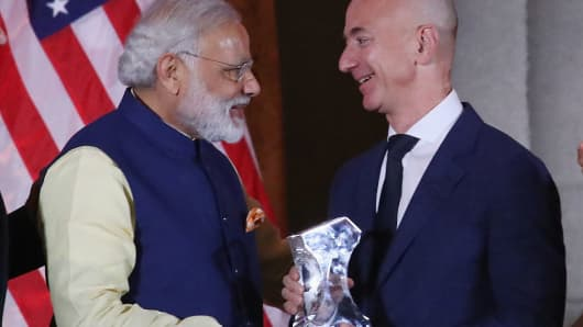 Jeff Bezos, CEO of Amazon,(R), is presented with the 2016 USIBC Global Leadership Award by Indian Prime Minister Narendra Modi during the forty-first Annual Leadership Summit at the Mellen Auditorium, June 7, 2016 in Washington, DC.