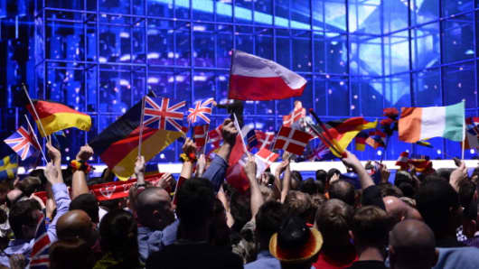 Supporters wave flags at the Eurovision Song Contest.