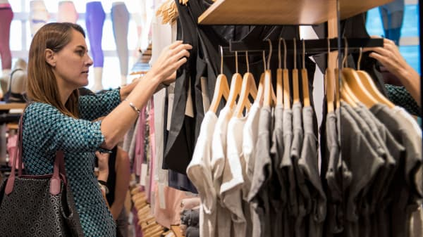 A customer looks at athletic apparel inside a Lululemon store.