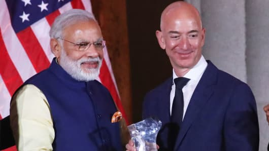 Jeff Bezos, right, CEO of Amazon, is presented with the 2016 USIBC Global Leadership Award by Indian Prime Minister Narendra Modi during the 41st Annual Leadership Summit at the Mellen Auditorium, June 7, 2016 in Washington.