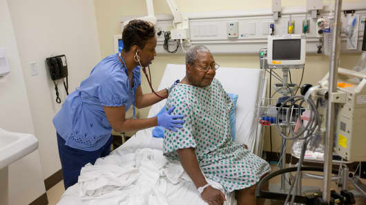 A patient is monitored in an examination room inside the Clinical Decision Unit at Kaiser Permanente's Capitol Hill Medical Center in Washington, D.C.
