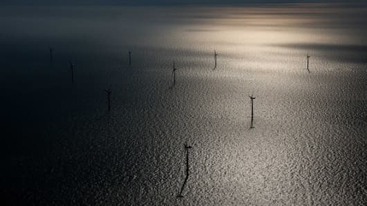 Wind turbines sit in the North Sea at the London Array offshore wind farm, a partnership between Dong Energy and Abu Dhabi-based Masdar.