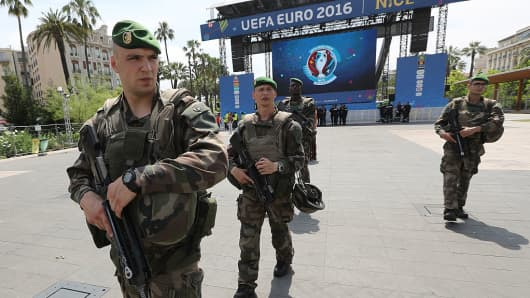 French soldiers patrol in the fan zone in Nice, southeastern France on June 8, 2016, two days before the start of Euro 2016.