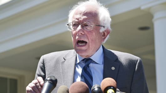 Democratic presidential candidate Bernie Sanders speaks to the press outside of the West Wing of the White House, June 9, 2016.