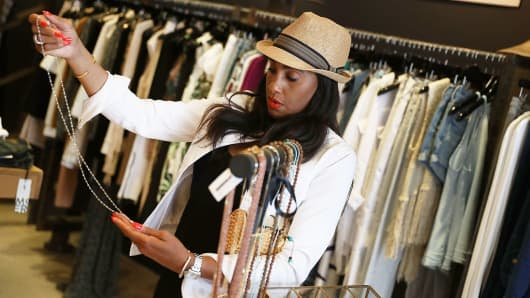 A woman shops for merchandise at the MVM Miami store in Miami.