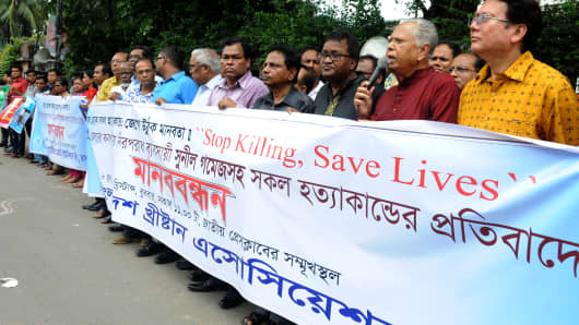 """The Bangladesh Christian Association protest on June 8, 2016 against the killing of Sunil Gomes and others in Dhaka. Unidentified attackers murdered the 65-year-old Sunil Gomes in the village of Bonpara, home to one of the oldest Christian communities in Muslim-majority Bangladesh. """"Sunil Gomes was hacked to death at his grocery store just near a church at Bonpara village,"""" said Shafiqul Islam, deputy police chief of Natore district."""