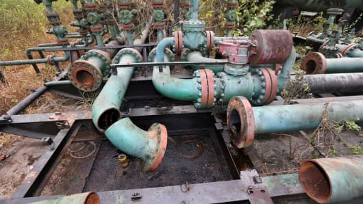 Broken pipework sits at an abandoned oil flow station operated by Royal Dutch Shell Plc in K-Dare, Nigeria, Jan. 13, 2016.