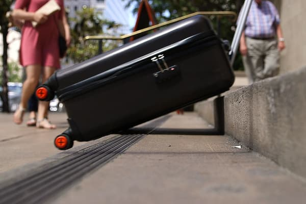 The suitcase has a track system that lets it glide up and down stairs.