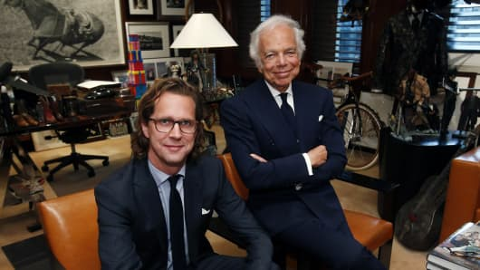 In this 2015 file photo, Ralph Lauren, right, poses in his office with CEO Stefan Larsson in New York.