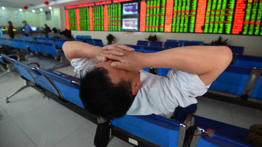 An investor reacts at an exchange hall in Fuyang, Anhui Province of China.