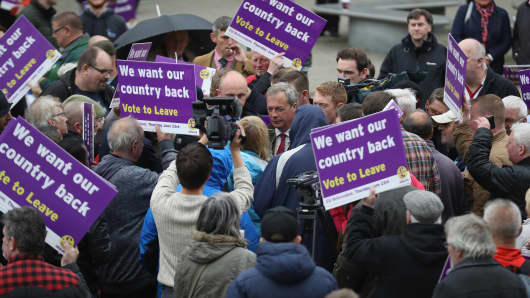 Leader of the United Kingdom Independence Party (UKIP), Nigel Farage talks to supporters as he campaigns for votes to leave the European Union
