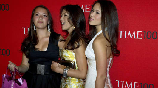 Amy Chua, center, and her daughters Sophia, right, and Lulu, left, at a Time Magazine event on April 26, 2011.