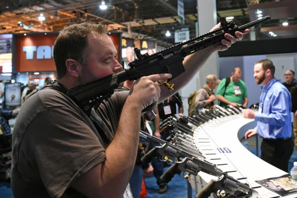 An attendee tries out an M&P 15-22 Sport rifle at the Smith & Wesson booth at the 2016 National Shooting Sports Foundation's Shooting, Hunting, Outdoor Trade (SHOT) Show at the Sands Expo and Convention Center on January 19, 2016 in Las Vegas, Nevada.